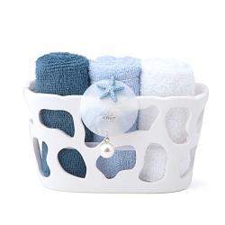 Candida Celiento - Hervit Creations, contenitore in porcellana traforata con set di asciugamani blu