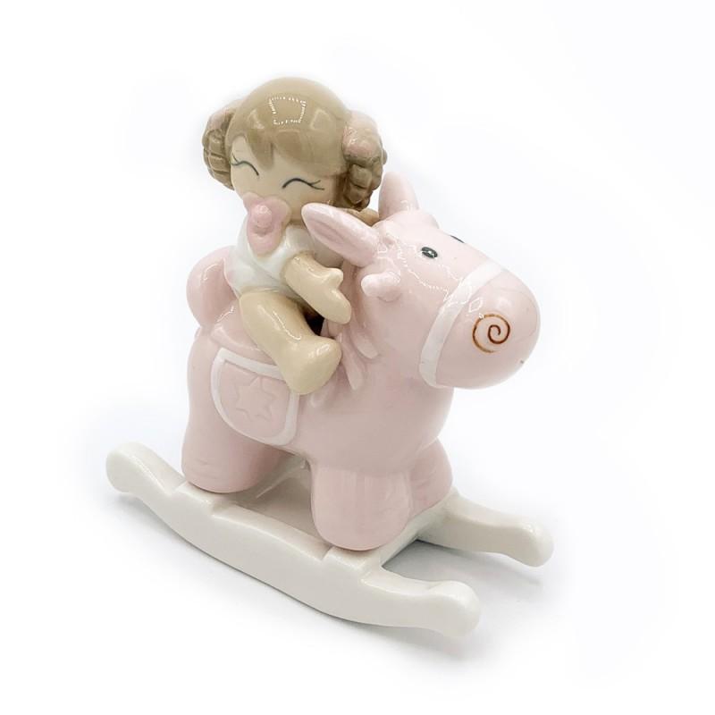 Ilary Queen - Bimba su cavalluccio rosa in porcellana h 12,5 cm